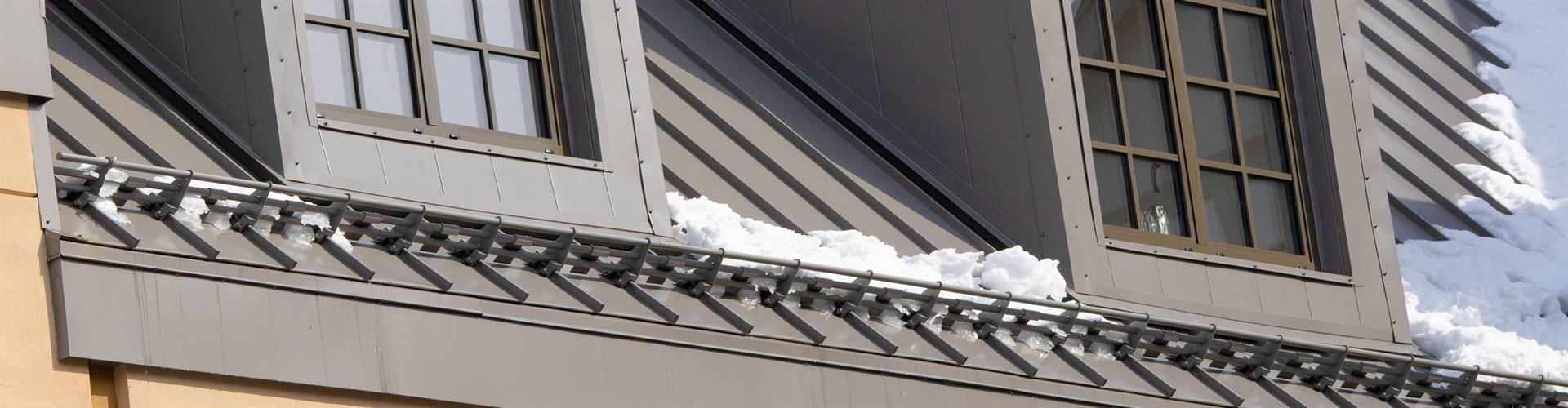 Precision Engineered, non-penetrative metal roof snow guards